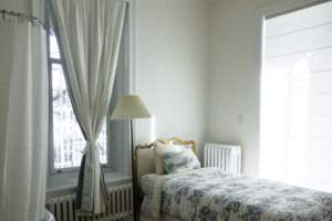 White bedroom with curtain